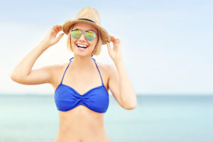 Photo Of A Woman On The Beach Smiling - The Dermatology Clinic