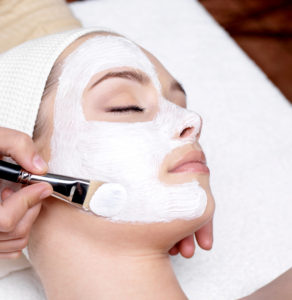 Cosmetician apply facial mask in Baton Rouge, LA